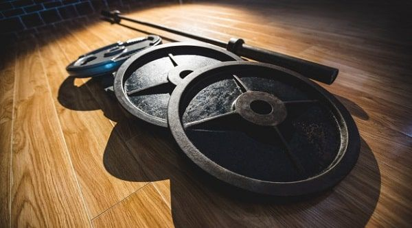 Discos con barra de pesas